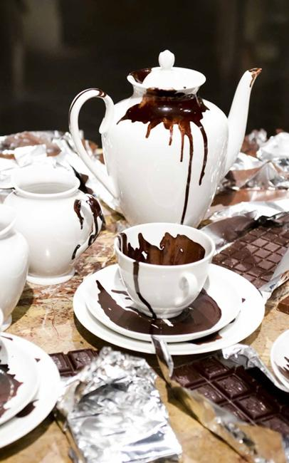 white teapot and cup chocolate spills