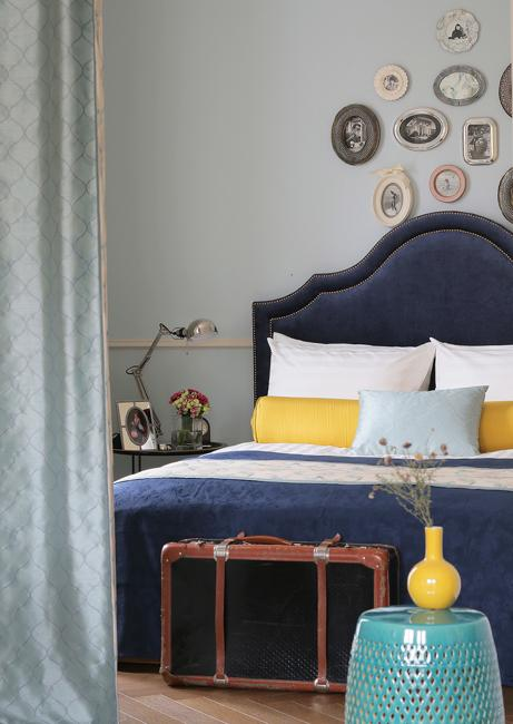 dark blue upholstered bed
