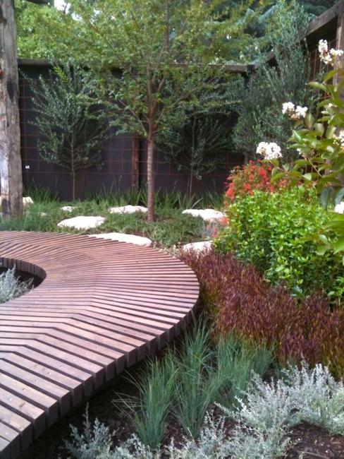 wood boards garden path between trees